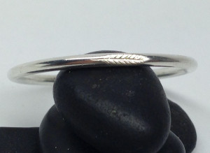 Feather engraved on sterling silver ring