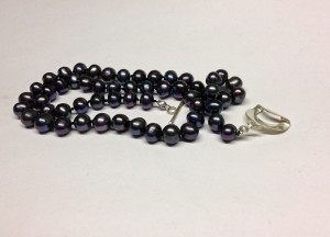 Hand tied fresh water pearls. Handcrafted sterling silver toggle. $60